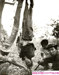 An interrogation by indigenous troops in the bush during the Vietnam War (Sean Flynn)