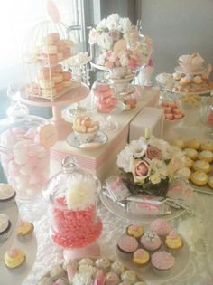 Lovely pastel-colored wedding dessert display - love the pink and white macarons #wedding #diywedding #weddingdessert #desserttable #pink