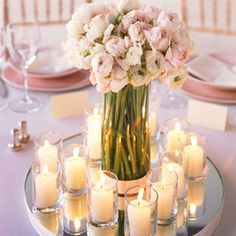 Mirror and votive: Decorate the center of the table with a circular mirror base and then place some small votive candles on top of it to make it look gleaming in brightness and beauty. This candle décor will just look perfect for a wedding evening.