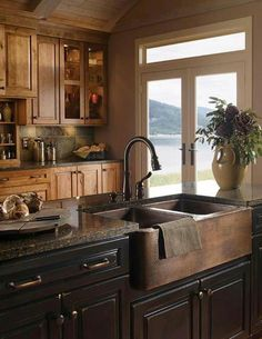 Mixing woods and what looks like a stunning hammered copper farmer's sink.