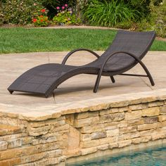 Maureen Outdoor Brown Wicker Folding Armed Chaise Lounge  Sunbathe in comfort on the Maureen chaise lounge chair. This wicker lounger promotes ventilation to keep you cool on a hot day. The ergonomic wave design is ideal for enjoying a book or keeping an eye on the kids in the pool. Lie confidently on the iron f  http://www.shareasale.com/m-pr.cfm?merchantID=69984&userID=1079412&productID=689115828