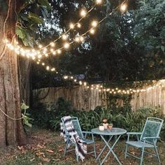 Lantern String Lights - Urban Outfitters String them from the patio to the trees and back. One set for each patio