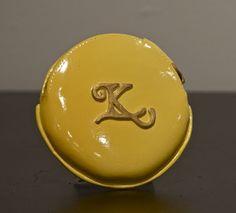 Yellow clay coin purse.