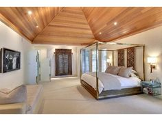 Gorgeous tongue and groove cedar, vaulted ceiling adds romance to the owners suite.