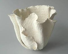 French artist Alice Riehl presses vintage lace and embroidery into her paper-thin porcelain vessels The effect is translucent and feminine with a lightness that defies gravity Alice Riehl, aliceriehlcom Click the link to visit our site Thrown Pottery, Slab Pottery, Pottery Vase, Pottery Clay, Ceramic Tableware, Ceramic Clay, Porcelain Ceramics, Porcelain Jewelry, Ceramic Bowls