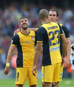 David Villa of Club Atletico de Madrid celebrates winning the La Liga with Diego Godin after the match between FC Barcelona and Club Atletico de Madrid at Camp Nou on May 17, 2014 in Barcelona, Catalonia.