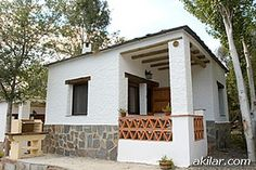 Budget Holiday Bungalow Rental in Sierra Nevada / Orgiva, includes a barbeque and jacuzzi barbeque, great for a couples gettaway:  http://www.akilar.com/listing--1554.html