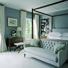 Blue bedroom with dark furniture