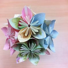 Kusudama Paper Flower Tutorial YT video... I always wondered how to make these, but never new what they were called!