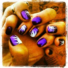 Purple nails with white design.