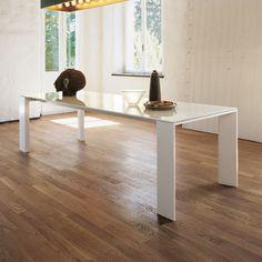 Plaza white glass dining table - sleek Italian styling for a fresh, modern interior.