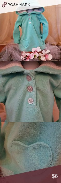 Mint Green Fleece Hoodie This soft silver sparkle 3 button hoodie will sure to make you want cuddles over and over! It's very soft and plush and very warm. The hoodie is lined with sherpa that will keep your little one very warm even on the coldest days. The heart shape pockets make it easy for hiding pacifiers! 🙊 Carter's Shirts & Tops Sweatshirts & Hoodies