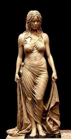 Incrível escultura em madeira