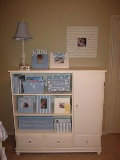 This looks lke an old entertainment center painted and with some shelved added. I like this idea lots.