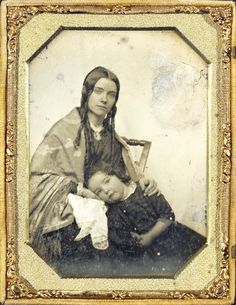 There is such tenderness in the way she nestles her son. Her eyes are full of motherly sympathy. From the kerchief beneath the boy's cheek, I think toothache is/was the problem. He is not in pain. Her eyes are so sweet, and she has a ring on her forefinger.