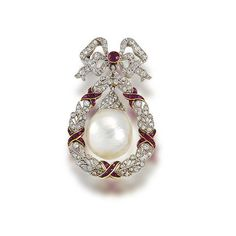 A belle époque freshwater natural pearl, ruby and diamond brooch,