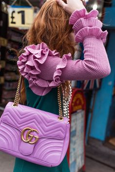 Madison Stubbington shows off an embroidered Gucci bag in the fashion shoot