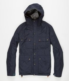 The 2.5L Totem Parka from Visvim. Constructed in Japan from a 2.5L Gore-tex fabric. Featuring four front patch pockets, adjustable hood, cuffs and waist, zip through front with press stud closure and inside zip pocket. Finished with a twill elbow patch on the left arm and corduroy patch on the right.