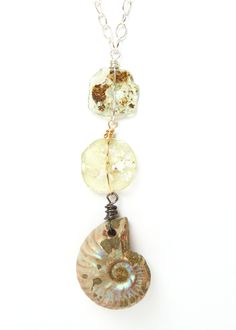"""Sterling Silver Necklace with Hand Drilled Ammonite and Button Ancient Glass. Ammonite: Ancient Fossil Ancient Glass: 900 (+) Years old, excavated in Afghanistan.   ONE OF A KIND  Fine Jewelry Handcrafted in Asheville, NC.   16"""" Length with 2"""" Extension  $88"""