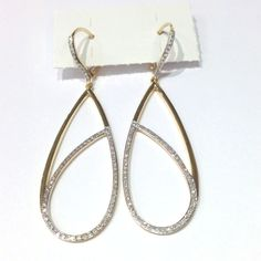 large pear shape dangling diamond earrings