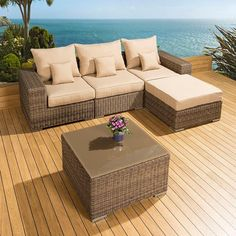 Luxury outdoor garden 5 piece sofa set/settee mocha rattan/beige cushions. Truly stunning in design, this large 3 seater sofa set gives a super high-class feel. This set consists of left and right hand end pieces, middle sofa piece, square glass topped coffee table, large footstool, clips to hold the pieces together, 3 x scatter cushions and heavy-duty covers in green. Call 02476 642139 or email sales@quatropi.com or visit www.quatropi.com for additional information.