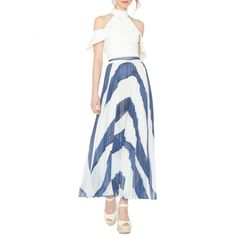 --evaChic--This Alice + Olivia Shannon Asymmetric Pleated Maxi Skirt from Resort 2017 is inspired by Jean-Michel Basquiat's graffiti-like paintings. Abstract wide stripes allude to a summery seawave motif while pleats give it a little more structure. Asymmetric hem offers the piece a modern twist.       https://www.evachic.com/product/alice-olivia-shannon-asymmetric-pleated-maxi-skirt/