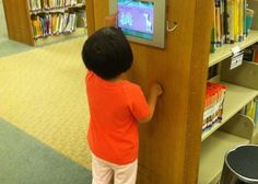 iPad mounted in children's library - I want to replace our catalog computer with this idea Library App, Teen Library, Dream Library, Elementary Library, Library Lessons, Library Design, Library Books, Library Ideas, Ipad Wall Mount