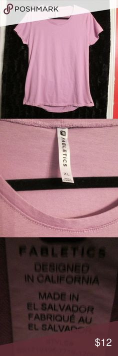 Fabletics Short sleeve Pink Top w/ Open Back XL Fabletics Short sleeve pink top with opening in the middle of the back. Really Soft and comfortable.  Size XL  Slight pilling.  50% polyester, 50% cotton  Thanks for visiting my closet!! Fabletics Tops Tees - Short Sleeve