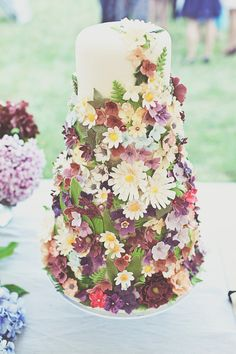 Three tier cake decorated with colourful sugar craft flowers | Photography by http://www.onloveandphotography.com/
