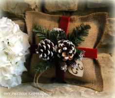 Burlap Ring Bearer Pillow Rustic Christmas Wedding Decor PERSONALIZED Wood Heart Custom (Your Color Choice of Ribbon and Flower). $29.95, via Etsy.