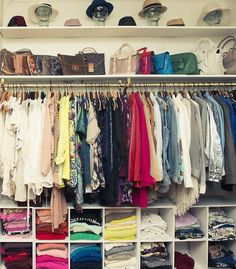 Love a well organized closet! Love the storage space underneath the racks. a possible idea for when we rip out our old wardrobe