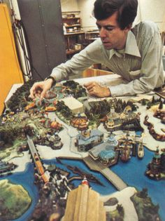 1970s: Walt Disney Imagineer Tony Baxter with a model of Discovery Bay and Dumbo's Circus for Disneyland.