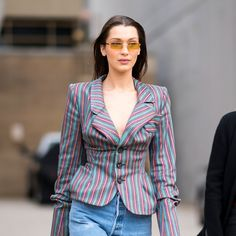 Bella Hadid pairs a middle-part with orange lenses.