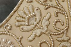 pearl embroidery detail White on rice, Baby. Pearl Embroidery, Tambour Embroidery, Couture Embroidery, Embroidery Fabric, Cross Stitch Embroidery, Embroidery Patterns, Beading Techniques, Embroidery Techniques, Couture Beading