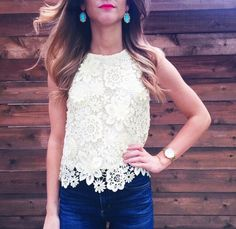 Super cute positing of a lacey blouse. Royal blue pants and turquoise earrings. Love the entire outfit