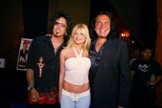 Nikki Sixx Donna D'Errico and Gene Simmons at the Gene Simmons' 'Tongue Magazine' release party at Barfly in West Hollywood Ca Tuesday June 11 2002...