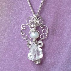 Tiny Angel - Crystal and Pearl Wire Wrap. $65.00, via Etsy - kjs