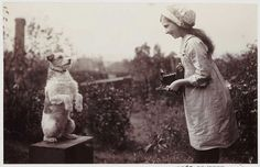 Girl photographing a dog, vintage photo