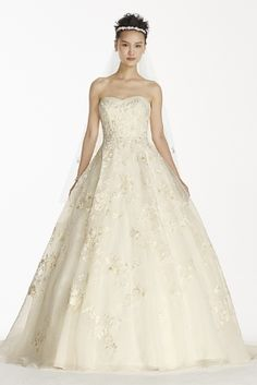 matte organza veiled lace ball gown, including a chapel train and layered floral appliques. Wedding dress choice A