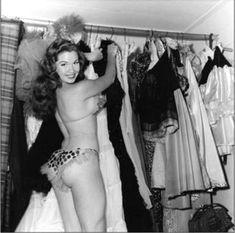 Tee Tee Red (aka. Joy Murphy) goes thru her costume rack