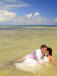 Using a fake dress for trash the dress photos...great idea! Still keeping the dress and getting great photos in the water...priceless