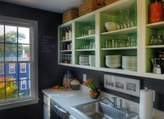 Remove doors, and cover walls with chalkboard contact paper, as well as paint the inside of the cabinets.