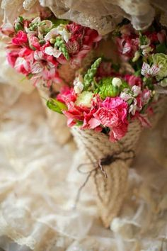 The bridesmaids held bouquets of pink alstromerias and carnations accented with sprays of snapdragons. Each bouquet was wrapped in abanico cones to channel the wedding's Filipiniana theme.