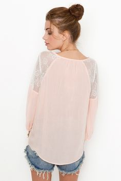 Sheer blouse with lace shoulder panels. This is the season of pale pink sheer outfits - girly lace details, ruffles and flowers.