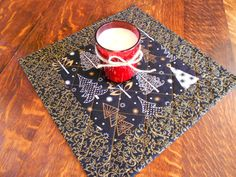Christmas Table Topper/ Quilted Candle Mat black and gold holiday print by RubysQuiltShop on Etsy