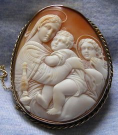 Image result for Donadio cameo, madonna of the chair, found similar that is in a different setting that can be either a brooch or a pendant.