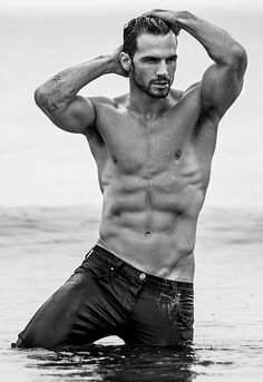 Sexy and fierce model Adam Cowie emerges from the water like Poseidon, his abs rippling as water sheets down his gorgeous chest and drips from his beard. #shirtless