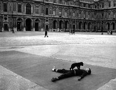 Robert Doisneau. Boy and Puppy. Square Patio, The Louvre. Paris 1969