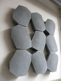 Really beautiful and simple concrete wall panel / sculpture. It's like an abstraction of boulders.