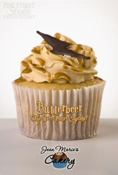 Jean Marie's Cakery ~ BUTTERBEER GOURMET CUPCAKE (THE HARRY POTTER CUPCAKE) ~ Cream Soda Cake, Madagascar Vanilla Cream Filling, Butterscotch Frosting, Butterscotch Genache Drizzle, and a Chocolate Lightning Bolt.